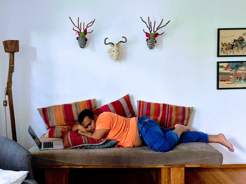 Asad Zulfahri sleeping on a couch while waiting for a meeting