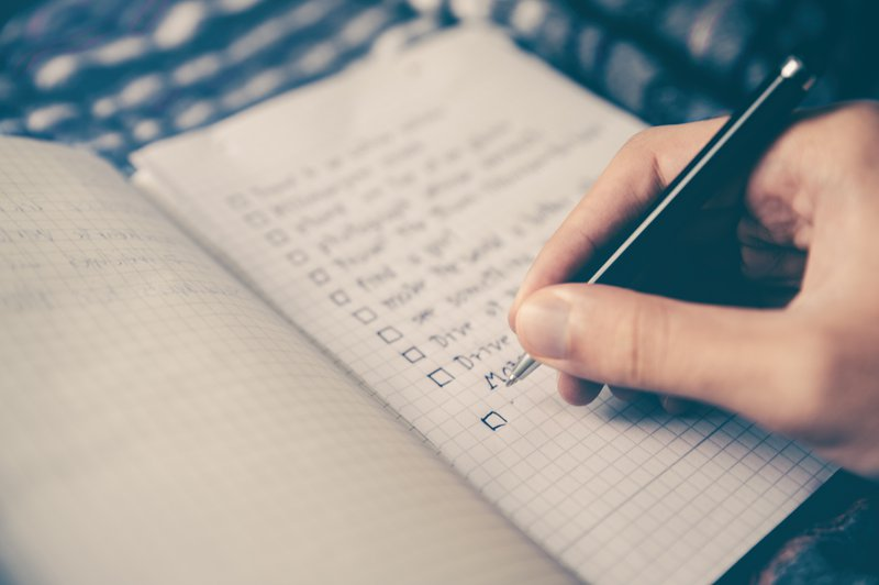 Writing Down a New Habit on A List on Paper with Pen