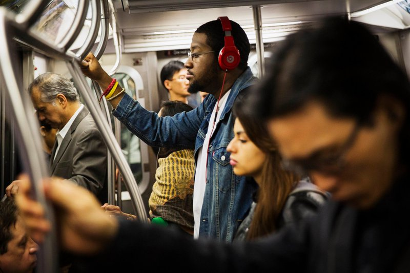 Commuter%20listening%20to%20music%20on%20the%20subway