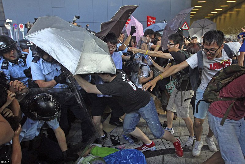 Hong Kong's umbrella-weilding protesters clash with riot police during the 'Umbrella Revolution'
