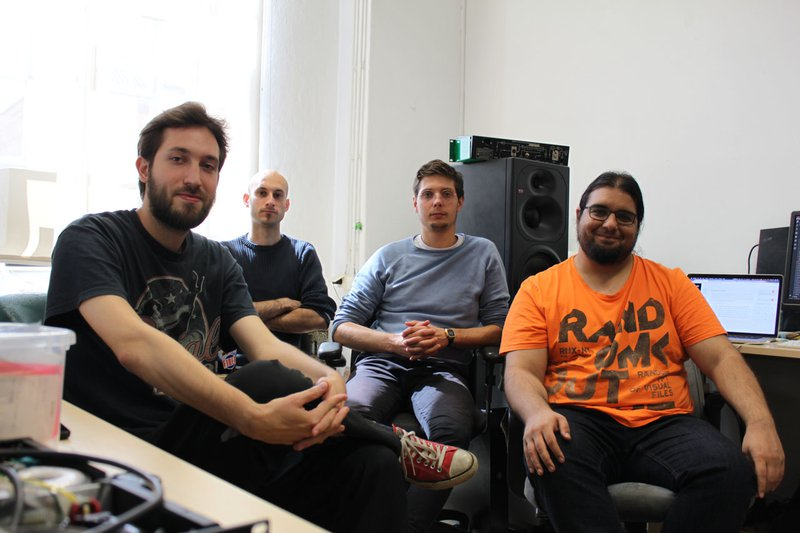 Photo of the team working on mix:analog and the blog.