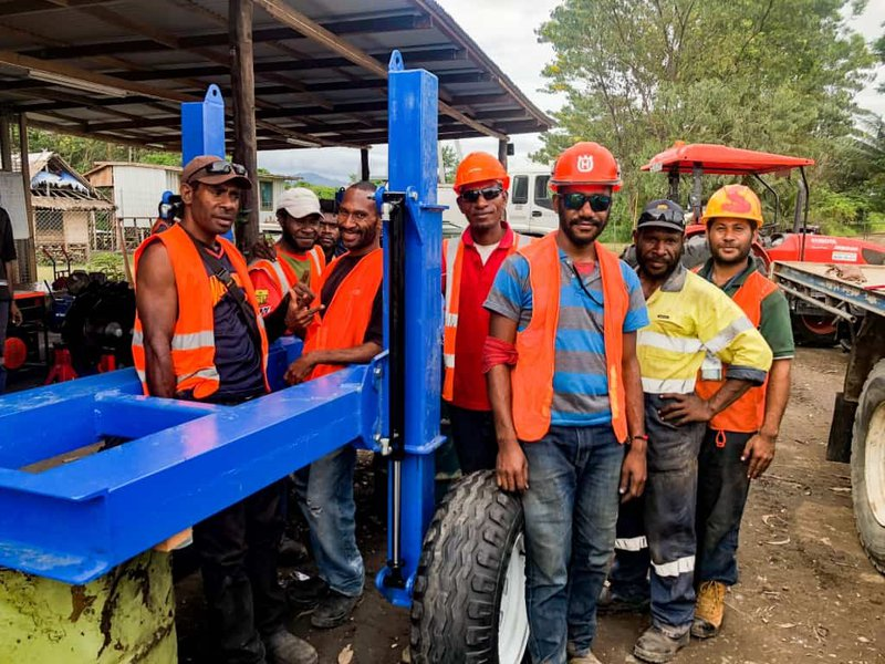 The PNG Biomass team trained by Carlos in the assembly and operation of the new equipment.