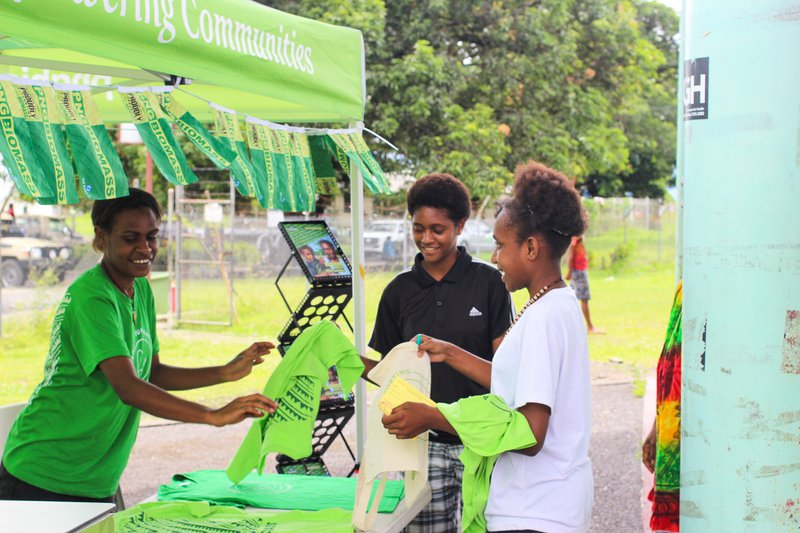 Young aspiring entrepreneurs visit the PNG Biomass booth to learn about the project and what it does to drive local inclusive economic growth and empower entrepreneurs in the Markham Valley.