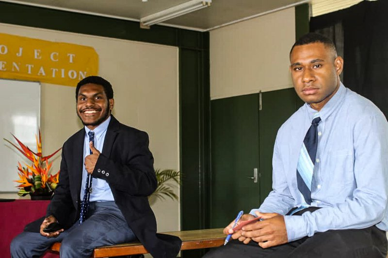 Unitech students Percy Wariambu and Simanibu Waram at the presentation of their final year project.