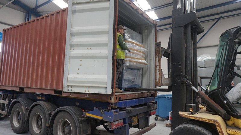 Loading a PET200 Pet Cremator into a container by Fork Lift Truck to ship an incinerator internationally.
