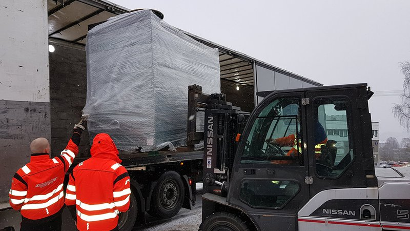 Unloading of a PET200 from a lorry by Fork Lift Truck in Norway.