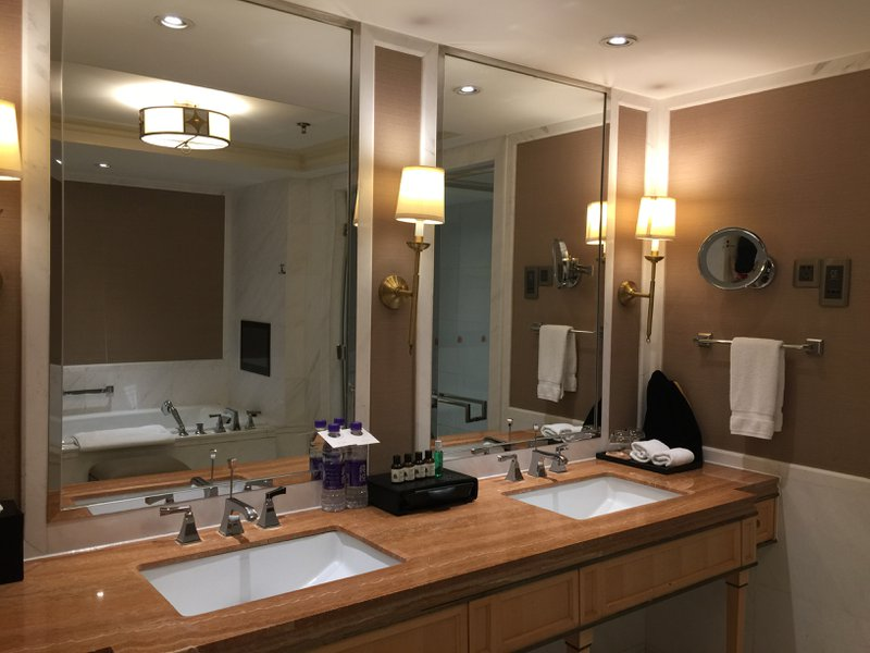 The Astor Hotel in Tianjin - Spacious bathroom and sinks on wooden legs