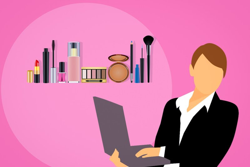 Woman with laptop and cosmetics in background