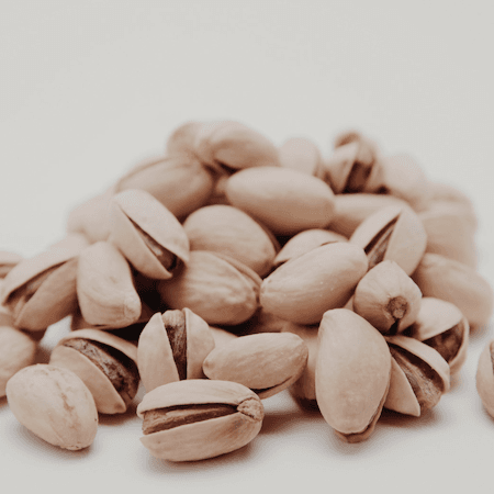 Pistachio nuts in a pile