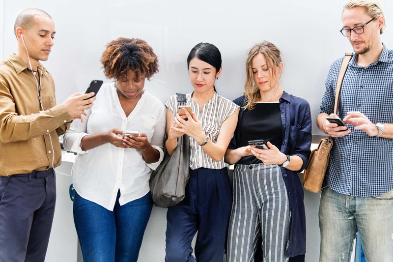 group of smartphone users looking for responsive websites