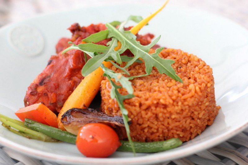 Jollof rice on a plate with garnishing